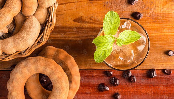 Top view, Copy space, Delicious sweet drink tamarind and ice with mint leaves