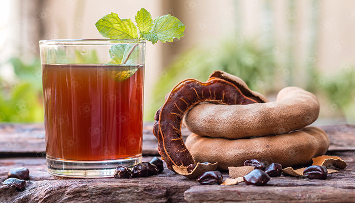 Tamarind juice, Delicious sweet drink tamarind, ripe tamarinds and seeds with mint leaves